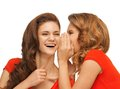 Two talking teenage girls in red t shirts picture of Royalty Free Stock Photography