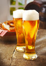 Two tall glasses of golden ale Royalty Free Stock Photo