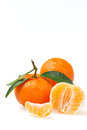Two tangerines with a peel and one peeled on white background Royalty Free Stock Photo