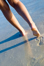 Two tanned women legs walking on beach Royalty Free Stock Photo