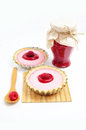 Two tarts and jar of raspberry jam Royalty Free Stock Photo