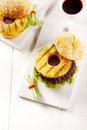 Two Tasty Hawaiian Burgers on White Plate Royalty Free Stock Photo