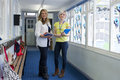 Two Teachers in School Corridor Royalty Free Stock Photo