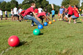 Two teams sprint for balls to begin dodge ball game atlanta ga usa september grab start a in a day kids an event where adults play Stock Photos
