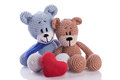 Two teddy bears with red heart pillow love Stock Image