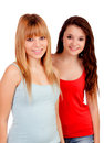 Two teen sisters isolated on white background Royalty Free Stock Images