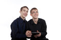 Two teenage boys playing on a Tablet PC Royalty Free Stock Images