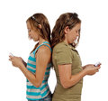 Two teenage girls communicating text messaging just talking sad true vertical shot isolated white background shot studio Stock Photography