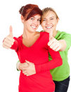 Two teenage girls, friends with thumbs up Royalty Free Stock Photography