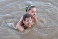 Two teenage girls having fun in the river Stock Image