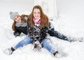 Two teenage girls having fun in the snow Royalty Free Stock Photo