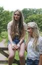 Two teenage girls outdoor both looking sad Stock Photography