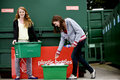 Two teenage girls recycling plastic bottles Royalty Free Stock Photo