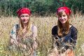 Two teenage girls sitting in corn field Royalty Free Stock Photo