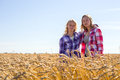 Two teenage girls wheat field Royalty Free Stock Photo