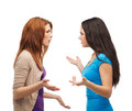 Two teenagers having a fight bullying friendship and people concept Royalty Free Stock Images