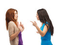 Two teenagers having a fight bullying friendship and people concept Stock Images