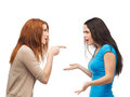 Two teenagers having a fight bullying friendship and people concept Royalty Free Stock Photos