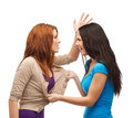 Two teenagers having a fight and getting physical bullying friendship people concept Royalty Free Stock Images