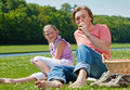 Two teenagers having picnic Stock Photography