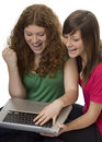 Two teenagers with laptop computer Royalty Free Stock Image