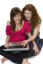Two teenagers with laptop computer Royalty Free Stock Photo