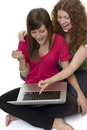 Two teenagers with laptop computer Stock Images