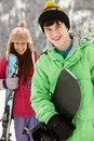 Two Teenagers On Ski Holiday In Mountains Royalty Free Stock Image