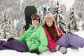 Two Teenagers On Ski Holiday In Mountains Stock Image