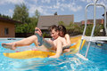 Two teenagers swimming in the pool Royalty Free Stock Photo