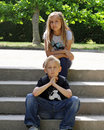 Two teenages on the park steps Stock Photos