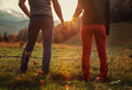 Two teens hand in hand romantic walk by the autumnal mountains