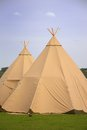 Two tepee a couple of in a field Stock Image