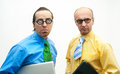 Two thoughtful businessman laptops Royalty Free Stock Images