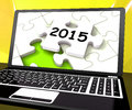 Two thousand and fifteen on laptop shows new years resolution showing Royalty Free Stock Photos