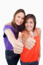 Two thumbs up being showed by teenagers Royalty Free Stock Image