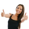 Two thumbs up photo of an excited young female doing the gesture over white background Royalty Free Stock Photography