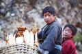 Two tibetan boys nepal with basket poses for the photo in nile village on november in tsum valley gorkha Stock Photos