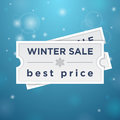Two tickets to the winter sale and best price on blue background Royalty Free Stock Image