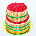 Two tier vanilla cake decorated with finetti stick fondant fresh raspberries and sticks Royalty Free Stock Image