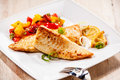 Two tilapia fish fillets on white plate Royalty Free Stock Photo