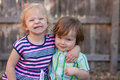 Two toddlers hugging and smiling caucasian blonde red haired grinning Royalty Free Stock Images