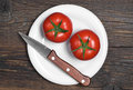 Two tomatoes and knife Royalty Free Stock Photo