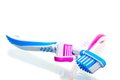 Two toothbrushes crossed on a white background Stock Images