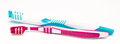 Two toothbrushes on white background closeup Royalty Free Stock Images