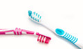 Two toothbrushes on white background closeup Stock Image