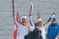 Two torchbearer on the embankment of the volga tver october river october tver russia in tver in olympic torch relay was Royalty Free Stock Photography