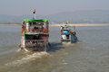 Two tourist boats go along the Irrawaddy river Irrawaddy. Myanmar