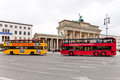Two tourist double decker buses in berlin germany october near brandenburg gate germany on october the gate were built by carl Stock Image