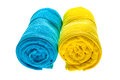 Two towels isolated blue and yellow on white background Royalty Free Stock Image